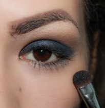 3. take glittery dark blue eyeshadow and apply in on the crease and blend it softly upwards; Brush- Sigma Eye Shading E55, Eyeshadow KIKO Infinity 410