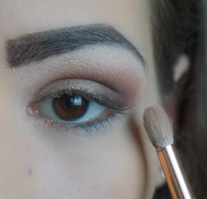 Apply glittery coral eyeshadow on top of the base eyeshadow to create additional dimension; Zoeva 231, 401