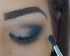 apply stick eyeshadow in the corner of your eye and on top apply similar eyeshadow and blend the harsh lines; shade- in the shade 04 and gunmetal on top; brush- Sigma e47