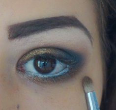 apply matte eyeshadow on the lower lash line and on top glittery one; shade- buck and on top smog; brush Sigma E30