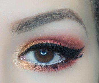 Create a dramatic cat eye and apply falsies. Don't forget to conceal under your eyes!