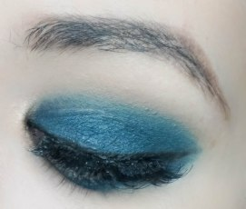 Line the lash line with black eyeliner, apply mascara, falsies...