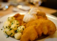 'WIENER SCHNITZEL'- thin slice of veal coated in breadcrumbs and fried. Served with boiled potato